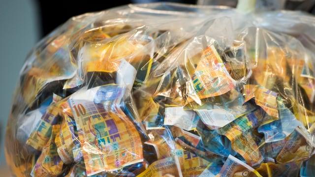 In satg da plastic transparent plain bancnotas da 10.-