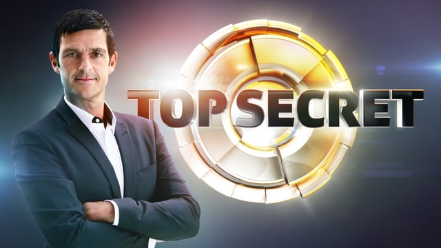 Roman Kilchsperger und «Top Secret» Logo