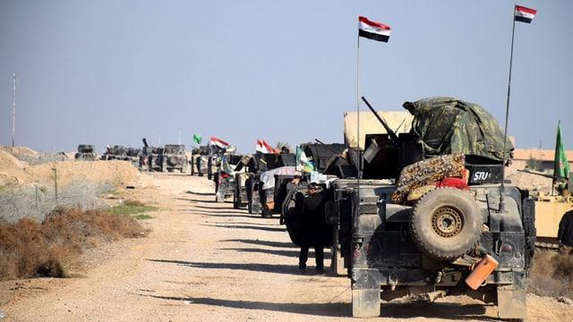 Ina caravana d'autos da l'armada iracaisa