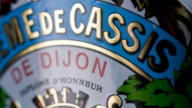 etichetta cun inscripziun Cassis de dijon