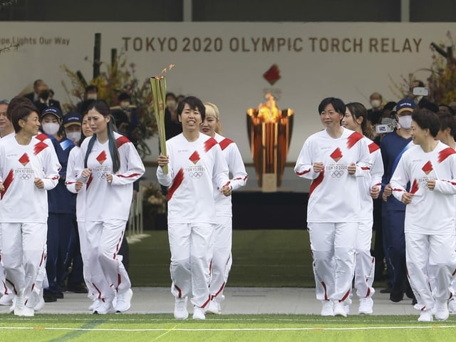 Der olympische Fackellauf.