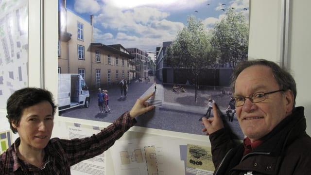 Kathrin Graber (CVP) und Peter Portmann (SVP) vor dem Bild, welches die geplante Überbauung des Teiggi-Areals zeigt.