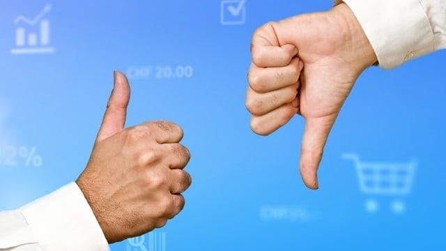 Zwei Hände, einmal Daumen nach oben, einmal nach unten.