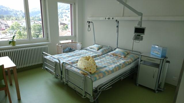 L'ospital porscha era ina stanza da famiglia en la partiziun da parturir.