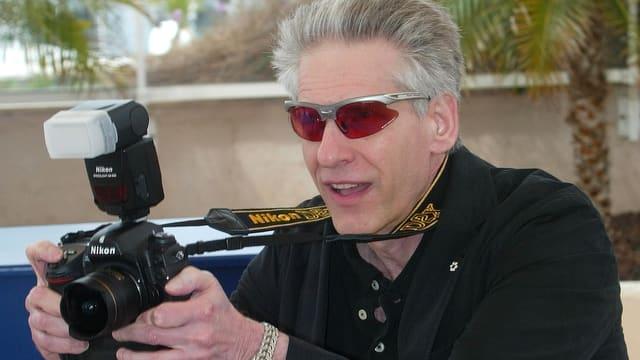Mann mit Fotoapparat