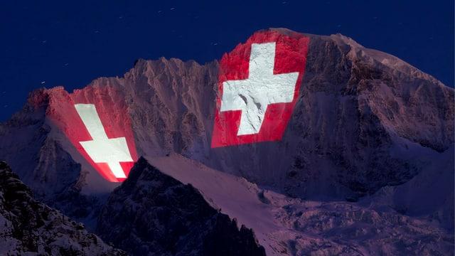 Symbolbild: Zwei riesige Schweizerkreuze werden auf die Jungfrau im Berner Oberland projiziert.