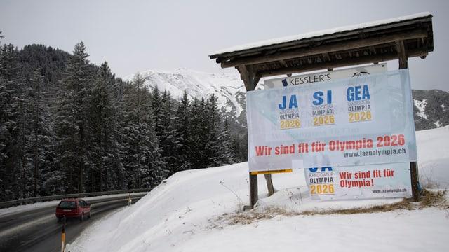 Am 12. Februar entscheiden die Stimmberechtigten im Kanton Graubünden über die Kandidatur. Plakat in Davos.