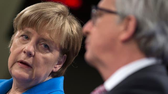 Angela Merkel e Jean-Claude Juncker