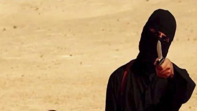Jihadi John, vestgì en nair e mussa in cuntè