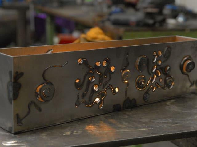 Kerzenobjekt aus Metall.