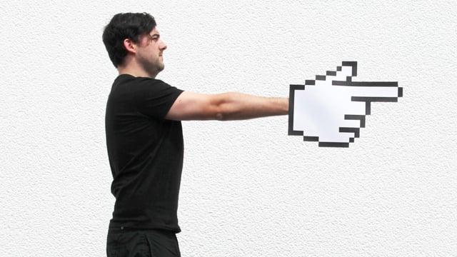 Ein Mann zeigt in eine Richtung. Seine Hand ist eine digitale Mickey-Maus-Hand.