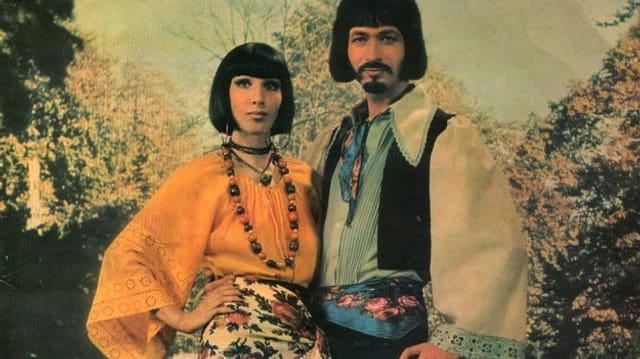 Frau mit prägnantem Pagenschnitt und Duettpartner mit Spitzbart.