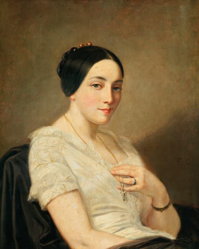 Porträt einer jungen Frau mit schwarzem Haar