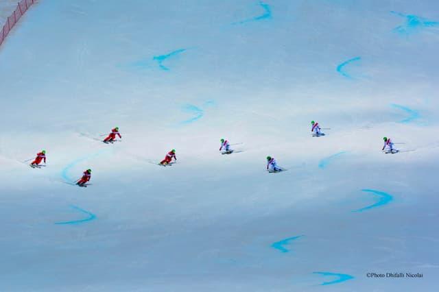 Furmaziun dad 8 magisters da skis.
