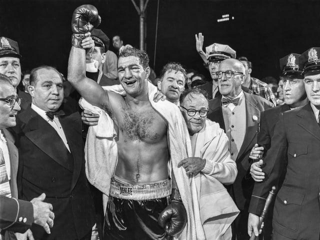 Rocky Marciano 1952 nach dem K.o.-Sieg gegen Joe Walcott.