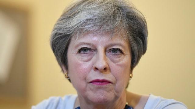 Ina foto da Theresa May.
