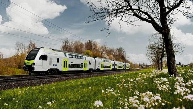 Ein BLS-Zug unterwegs in einer Frühlingslandschaft.