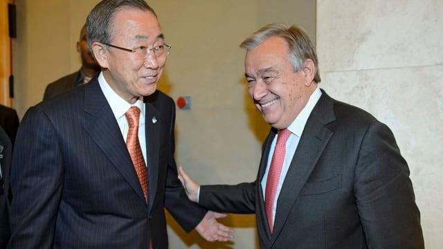 Lachende Ban Ki Moon und António Guterres