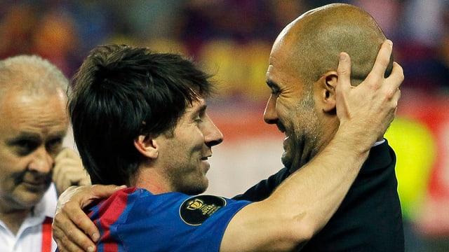 Pep Guardiola mit Lionel Messi.