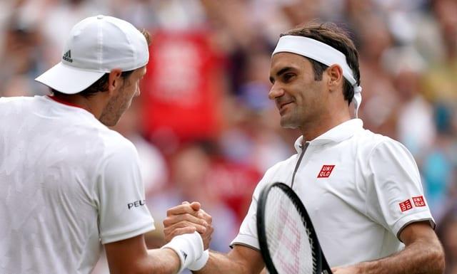 Lucas Pouille e Roger Federer.