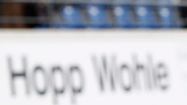 Schild Hopp Wohle im Stadion Niedermatten.