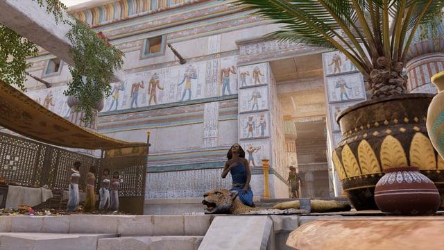 Eine Frau sitzt auf einem Löwenfell, vier weitere stehen im Hintergrund.