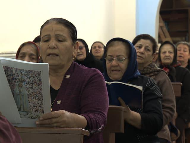 Betende Frauen.