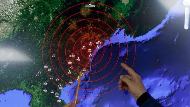 Ina charta seismologica cun dus mauns.