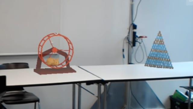 Ein animiertes GIF zeigt, wie Holovect einfache Vektor-Hologramme in die Luft zeichnet.