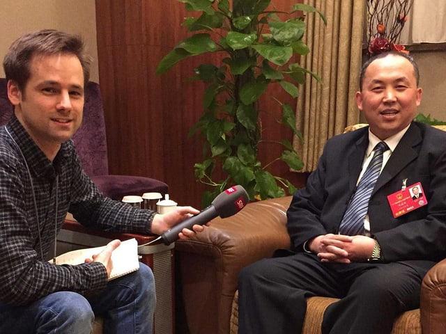 Martin Aldrovandi im Interview mit einem chinesischen Abgeordneten.