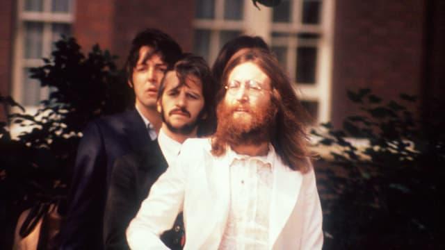 Paul McCartney, Ringo Starr und John Lennon.