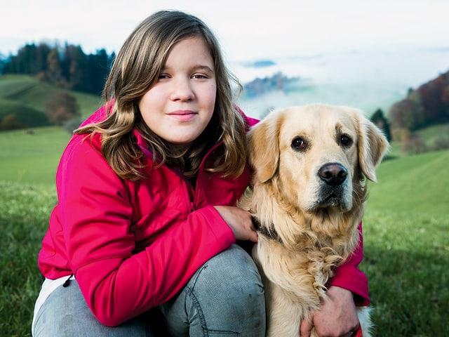 Sylvana mit einem der Hunde.