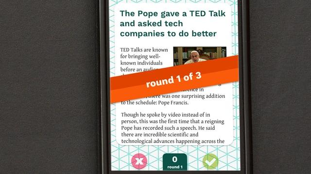 Ein Bildschirm, der eine Nachrichten über den Papst zeigt.