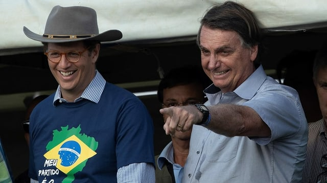 n Minister of the Environment, Ricardo Salles (L), and President of Brazil, Jair Bolsonaro (R), participate in the March of the Christian Family for Freedom, in Brasilia, Brazil, 15 May 2021. Supporters of Bolsonaro promoted rallies throughout Brazil as the head of stateâÄ™s popularity is at its lowest level since he took office. EPA/Joedson Alves