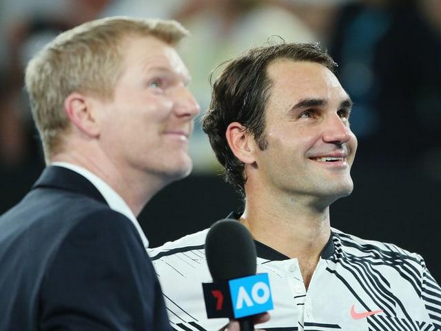Jim Courier und Roger Federer.