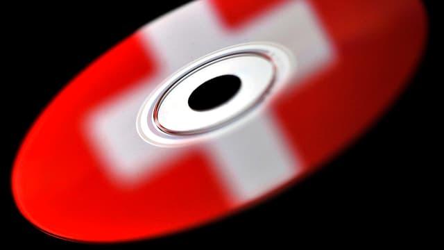 CD, auf der ein Schweizerkreuz zu sehen ist.