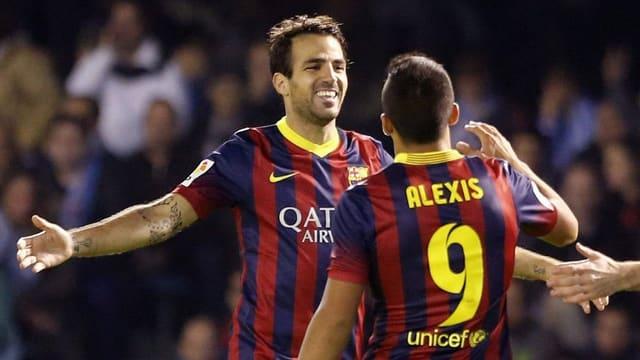 Cesc Fabregas (l.) und Alexis Sanchez.