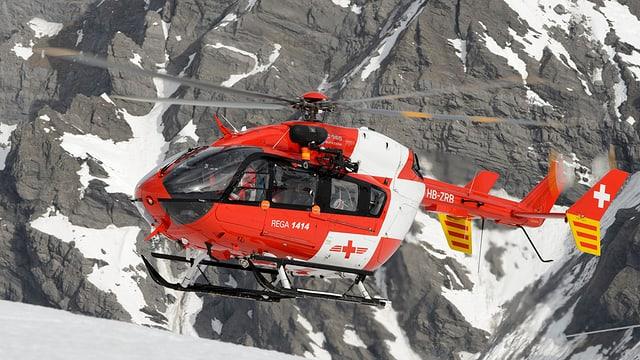 Purtret d'in helicopter da la Rega.