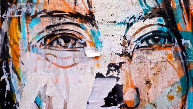 Graffito auf einer Wand: Zwei Augen mit Brauen, die Nase ist angetönt.