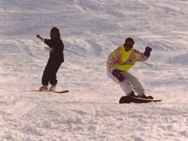 Snowboarding anno 1986 am Bolgen in Davos, in Leuchtgelb.