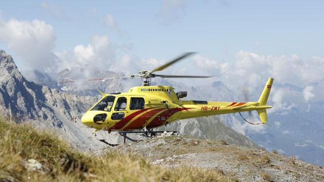 Maletg simbolic; in helicopter platgà sin la muntogna