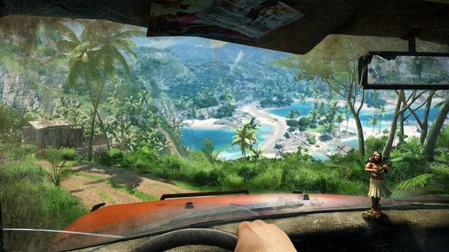 Durch die Windschutzscheibe ein Blick auf Palmen und blaue Lagune.