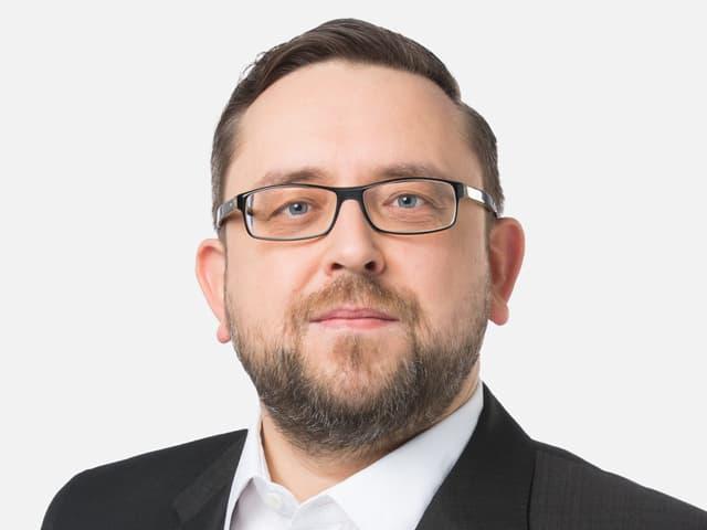 Purtret da Adrian Camartin, correspondent en Chasa federala a Berna