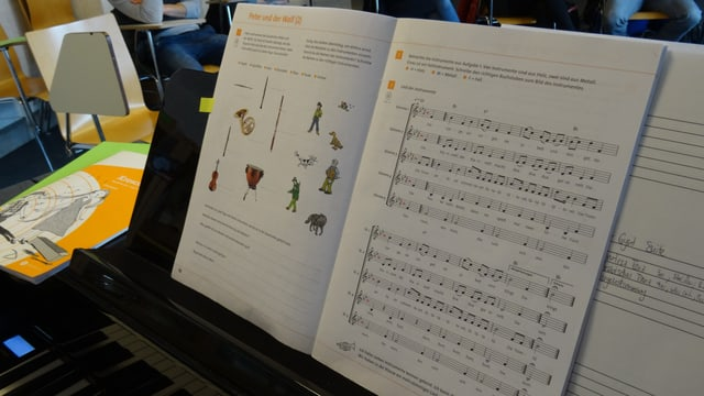 med d'instrucziun per chant e musica sin clavazin