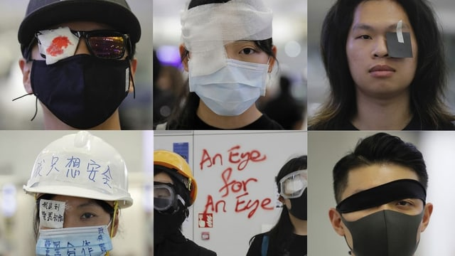 Demonstranten mit Augenbinde.