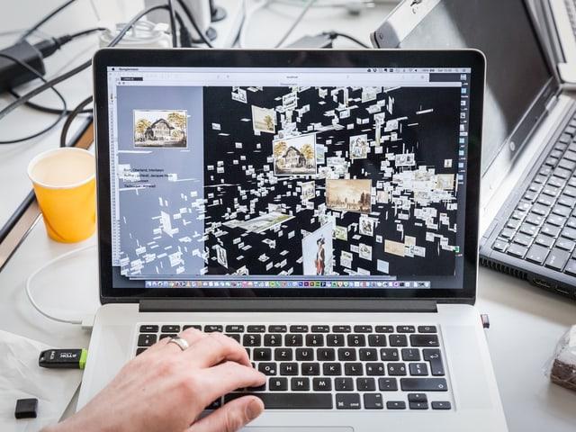 Auf einem Computerbildschirm sind kleine Bilder als 3D-Wolke zu sehen.