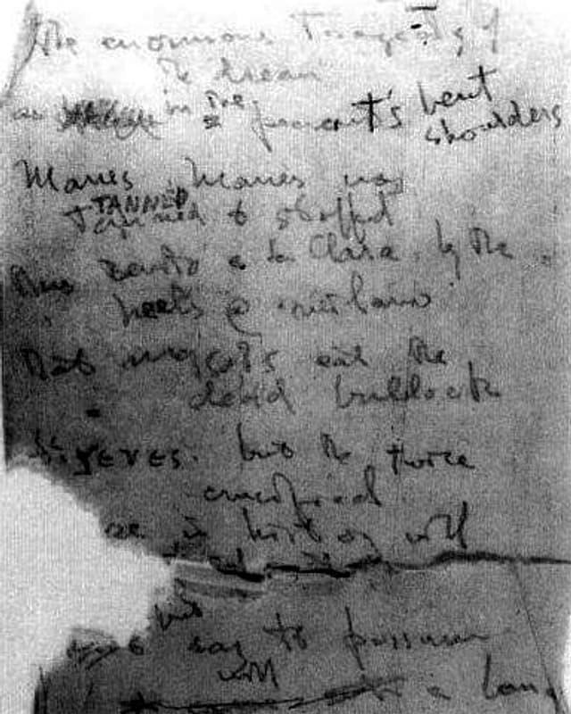 Ein Textfragment in schwarz-weiss, mit einem Text in unleserlicher Handschrift.