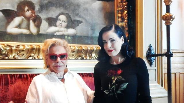 Ornella Vanoni (san.) e Dita Von Teese (dre.).