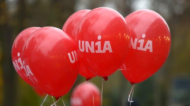 Purtret da balluns cun il logo da l'Unia.