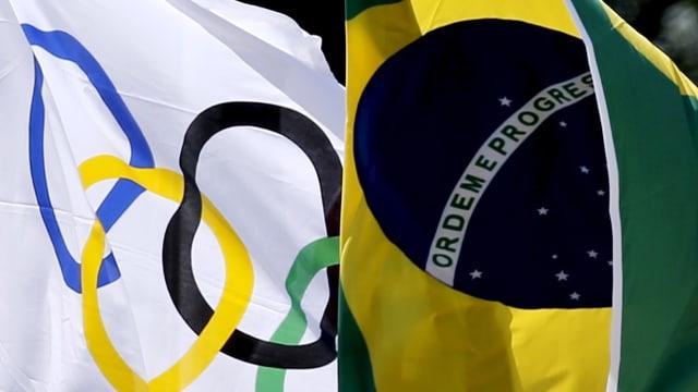 Die olympische und brasilianische Flagge wehen nebeneinander.